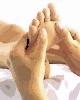 Cómo dar un masaje en los pies